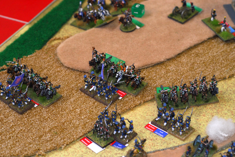 French dragoons from Strolz division charge prussian landher squares. Two squares hold one not.